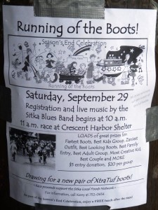 Duct tape holds a Running of the Boots poster to a post near Sitka's waterfront. The event is part of cruise-season's-end celebration.