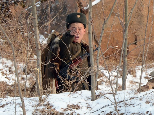 A North Korean soldier reacts as he patrols along the Yalu River near the Chinese border last month. Mark Ralston/AFP/Getty Images