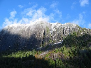 Sprinkles of snow dot precipitous cliffs. Rudyerd Bay area, Southeast Alaska.