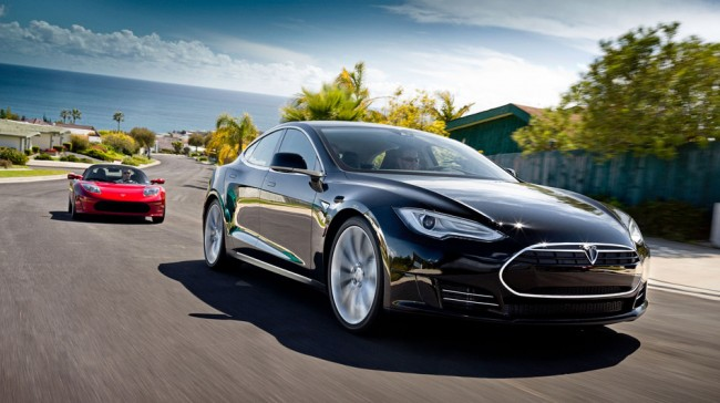 Tesla Motors has outsold several luxury carmakers in California in 2013, on the strength of its Model S, seen here in the foreground. The Telsa Roadster is behind it. James Lipman/Telsa