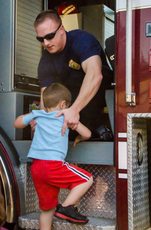 Probationary firefighter Cody Carver assisted dozens of kids in and out of fire trucks throughout the evening.