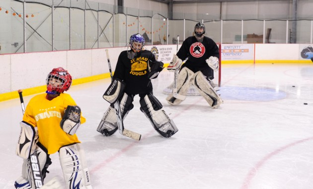Goalies come in all size as they listen to instructions from coach Matt Noreen.