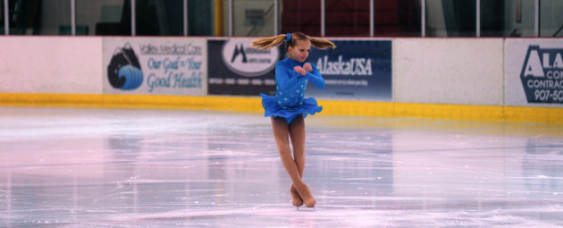 Tessa Murphy's pig tails go flying as she spins during the Free Skate 1 competition category.