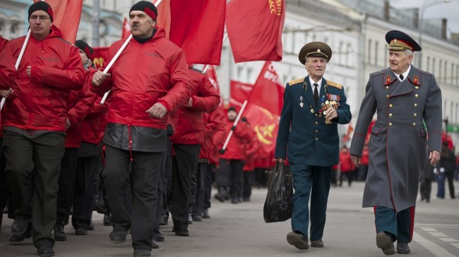 Russia has vetoed a U.N. Security Council resolution that would invalidate Sunday's referendum in Crimea. In Moscow, demonstrators and military veterans march in support of the Kremlin Saturday; nearby, a large march was held to protest Russia's policies. Alexander Zemlianichenko/AP
