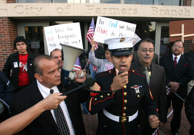 Former Marine Sgt. Salvadaor Parada, right, speaks to protesters during a rally outside city hall in Farmers Branch, Texas in 2006. Rex C. Curry/AP