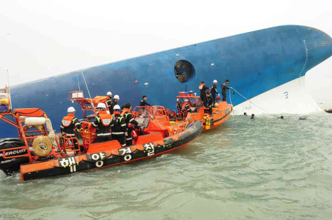 Republic of Korea Coast Guard continues their rescue work around the site of ferry sinking accident off the coast of Jindo Island on Wednesday in Jindo-gun, South Korea. Four people are confirmed dead and almost 300 are reported missing. The ferry identified as the Sewol is reported to have been carrying around 470 passengers, including students and teachers, as it travelled to Jeju island. The Republic of Korea Coast Guard/Getty Images