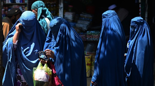 Afghan women shop in Kabul Saturday. Women cast more than a third of the ballots — 36 percent — in Afghanistan's presidential election, officials said. The race will likely head to a runoff next month. (Wakil Koshar/AFP/Getty Images)