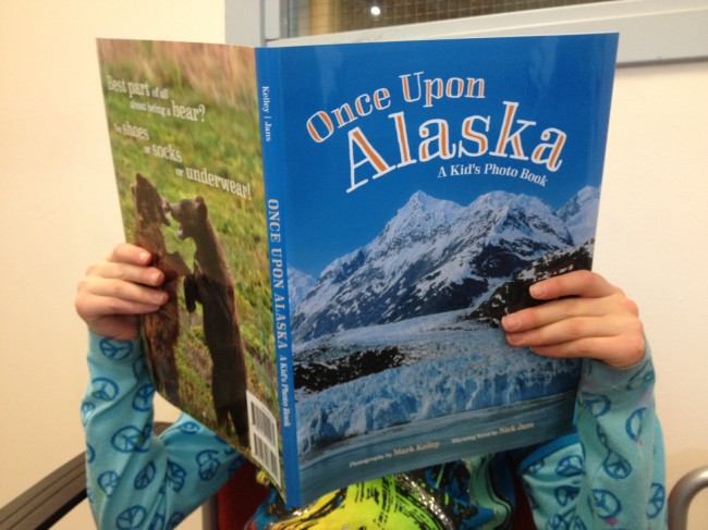 """Once Upon Alaska, A Kid's Photo Book"" is a collaboration between writer Nick Jans and photographer Mark Kelley. (Photo by Lisa Phu/KTOO)"