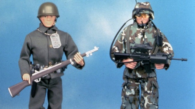At left is a reproduction of the original G.I. Joe action figure made in 1964. The doll on the right is a newer G.I. Joe model. Hasbro executive Donald Levine, who oversaw the action figure's creation, died last week of cancer. Anonymous/AP