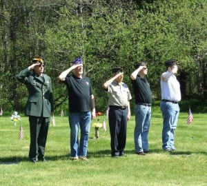 Veterans salute the flag at the 2013 Memorial Day observance at Alaskan Memorial Park. (Photo by Rosemarie Alexander/KTOO)