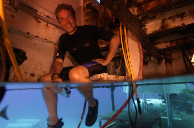 Fabien Cousteau sits inside Aquarius Reef Base in 2012. If he is able to remain under water for 31 days, he will have lasted one day longer than his grandfather, Jacques Cousteau. Mark Widick/AP
