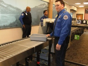TSA Officer Noah Teshner at Juneau International Airport.  (Photo by Rosemarie Alexander/KTOO)