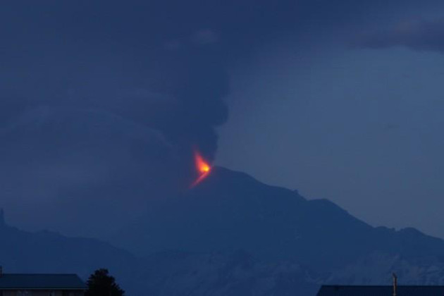 Pavlof in eruption, with lava fountaining and ash plume, in the early hours of June 4, 2014 as seen from Cold Bay. (Photo courtesy AVO/Robert Stacy)